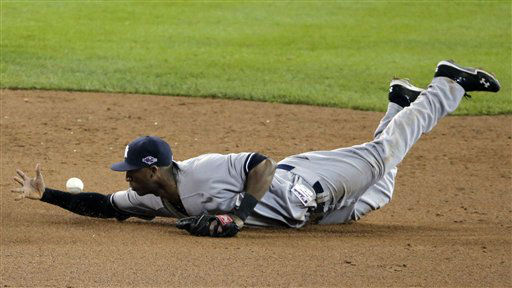 New York Yankees&#39; Eduardo Nunez makes a play on a ball hit by Detroit Tigers&#39; Andy Dirks in the fifth inning during Game 3 of the American League championship series Tuesday, Oct. 16, 2012, in Detroit. &#40;AP Photo&#47;Charlie Riedel&#41; <span class=meta>(AP Photo&#47; Charlie Riedel)</span>