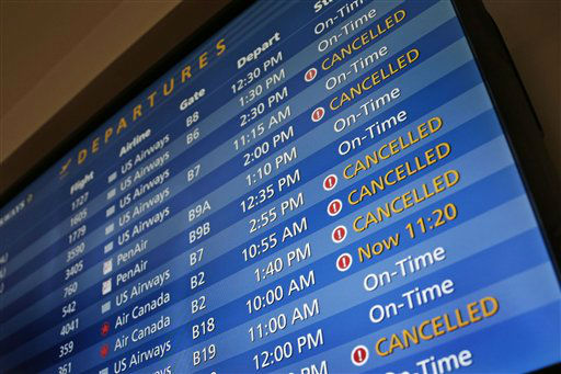 "<div class=""meta image-caption""><div class=""origin-logo origin-image ""><span></span></div><span class=""caption-text"">TV monitors at Logan International Airport in Boston show cancelled flights Friday morning, Feb. 8, 2013. (AP Photo/Gene J. Puskar) (Photo/Gene J. Puskar)</span></div>"