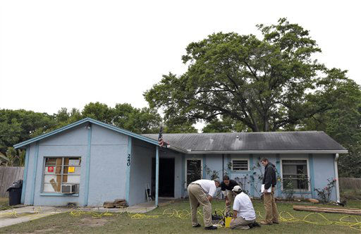 "<div class=""meta ""><span class=""caption-text "">Engineers work in front of a home where sinkhole opened up underneath a bedroom and swallowed a man Friday, March 1, 2013, in Seffner, Fla.  Jeff Bush screamed for help and disappeared as a large sinkhole opened under the bedroom of his house, his brother said Friday. Jeremy Bush told rescue crews he heard a loud crash near midnight Thursday, then heard his brother screaming.  There's been no contact with Jeff Bush since then, and neighbors on both sides of the home have been evacuated. (AP Photo/Chris O'Meara) (AP Photo/ Chris O'Meara)</span></div>"
