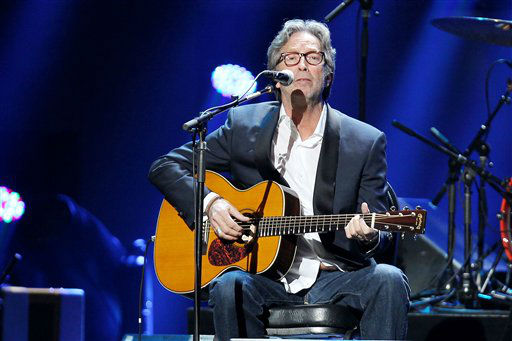 "<div class=""meta ""><span class=""caption-text "">This image released by Starpix shows Eric Clapton performing at the 12-12-12 The Concert for Sandy Relief at Madison Square Garden in New York on Wednesday, Dec. 12, 2012. Proceeds from the show will be distributed through the Robin Hood Foundation. (AP Photo/Starpix, Dave Allocca) (AP Photo/ Dave Allocca)</span></div>"