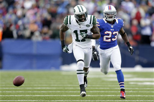 New York Jets wide receiver Braylon Edwards &#40;17&#41; and Buffalo Bills cornerback Aaron Williams &#40;23&#41; watch as the ball bounces away during the second half of an NFL football game on Sunday, Dec. 30, 2012, in Orchard Park, N.Y. &#40;AP Photo&#47;Gary Wiepert&#41; <span class=meta>(AP Photo&#47; Gary Wiepert)</span>
