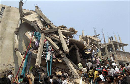 "<div class=""meta ""><span class=""caption-text "">Rescue workers and people look for survivors after an eight-story building housing several garment factories collapsed in Savar, near Dhaka, Bangladesh, Wednesday, April 24, 2013. Dozens were killed and many more are feared trapped in the rubble. (AP Photo/ A.M. Ahad) (AP Photo/ A.M. Ahad)</span></div>"