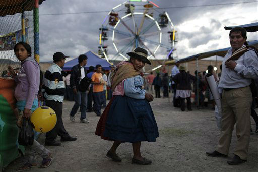 An indigenous woman walks at Canaan fair, which is part of  Holy Week events in Ayacucho, Peru, Thursday, March 28, 2013. Catholics around the world commemorate Jesus&#39; crucifixion on Good Friday before celebrating his resurrection on Easter Sunday. &#40;AP Photo&#47;Rodrigo Abd&#41; <span class=meta>(AP Photo&#47; Rodrigo Abd)</span>