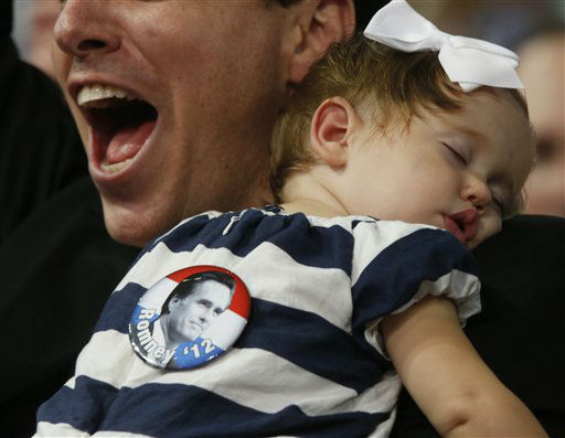 Kyle Welch from Cambridge, Mass., cheer as his 1-year-old daughter Lillian sleeps during the Republican National Convention in Tampa, Fla., on Tuesday, Aug. 28, 2012. &#40;AP Photo&#47;Jae C. Hong&#41; <span class=meta>(AP Photo&#47; Jae C. Hong)</span>