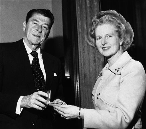 FILE - In this April 9, 1975 file photo, former California Governor Ronald Reagan presents a silver dollar medallion to Opposition Leader Margaret Thatcher when he visited her office at the House of Commons in London.  Ex-spokesman Tim Bell says that Thatcher has died. She was 87. Bell said the woman known to friends and foes as &#34;the Iron Lady&#34; passed away Monday morning, April 8, 2013. &#40;AP Photo&#47;File&#41; <span class=meta>(AP Photo&#47; Gerald Penny)</span>