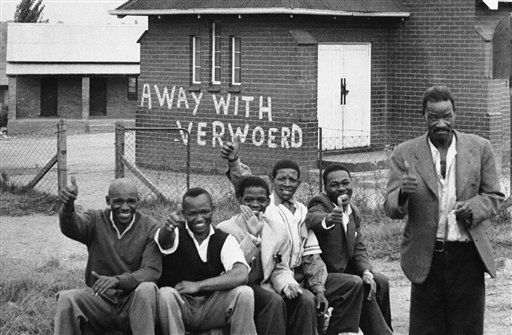 "<div class=""meta image-caption""><div class=""origin-logo origin-image ""><span></span></div><span class=""caption-text"">FILE- In this March 28 1960 file photo, members of the African National Congress  take part in a day of mourning at Orlando East, near Johannesburg, South Africa. Against all odds, the party of Nelson Mandela which  has transformed a nation where just 20 years ago black South Africans could not vote, and beaches and restaurants were reserved for whites only, is celebrating its 100th anniversary in Bloemfontein Sunday Jan 8 2012. Building in background has words ""away with Verwoerd"" painted on it. Verwoerd was South Africa's Prime Minister and strong proponent of the racial policies which led to the mass shooting at Sharpesville. (AP Photo/file) (AP Photo/ JD JW**LON**)</span></div>"