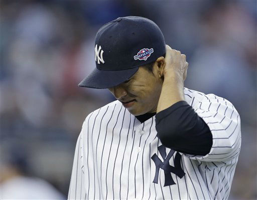New York Yankees&#39; pitcher Hiroki Kuroda grimaces as he walks to the dugout after the seventh inning of Game 2 of the American League championship series against the Detroit Tigers Sunday, Oct. 14, 2012, in New York. &#40;AP Photo&#47;Paul Sancya &#41; <span class=meta>(AP Photo&#47; Paul Sancya)</span>