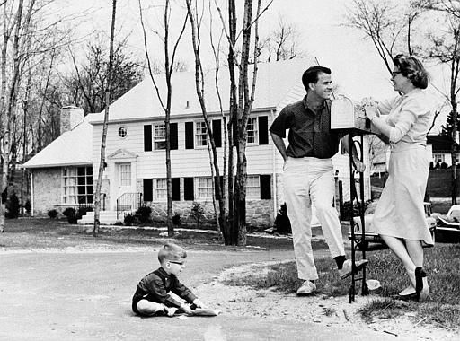 "<div class=""meta ""><span class=""caption-text "">Television star Dick Clark, his wife Barbara, and their son, Richard 3 1/2 outside their home outside Philadelphia, Pa., July 26, 1960. Dick hosts two ABC-TV shows, ""The Dick Clark Show"" on Saturdays and ""American Bandstand"" Monday through Friday. The Clark family threesome in front of the newly purchased home. (AP Photo) (AP Photo/ XJFM RCC)</span></div>"