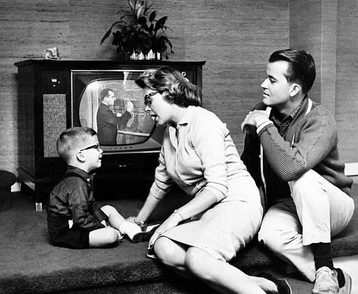 "<div class=""meta ""><span class=""caption-text "">The Clark's son Richard, 3 1/2, wins over the television screen in getting attention from his parents, Dick Clark and Barbara Mallery in their recently purchased suburban home near Philadelphia, Pa., July 26, 1960. (AP Photo) (AP Photo/ XJFM RCC)</span></div>"