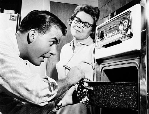 As his wife Barbara Mallery looks on Dick Clark does a bit of kitchen policing at their new suburban home near Philadelphia, PA., July 26, 1960. &#40;AP Photo&#41; <span class=meta>(AP Photo&#47; XJFM RCC)</span>