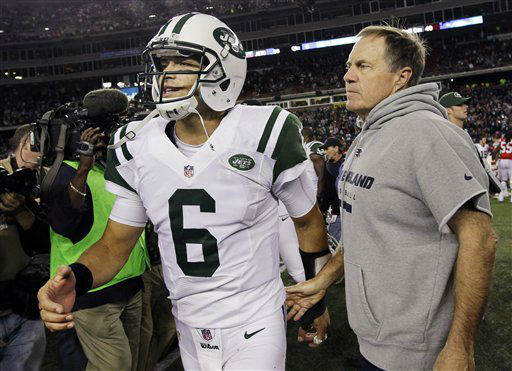 New England Patriots head coach Bill Belichick, right, meets New York Jets quarterback Mark Sanchez &#40;6&#41; on the field at the end of an NFL football game in Foxborough, Mass. Sunday, Oct. 21, 2012. The Patriots won 29-26 in overtime. &#40;AP Photo&#47;Elise Amendola&#41; <span class=meta>(AP Photo&#47; Elise Amendola)</span>