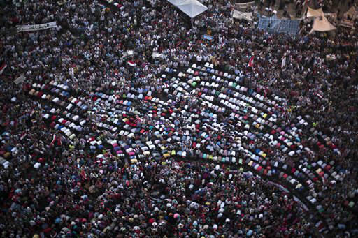 "<div class=""meta image-caption""><div class=""origin-logo origin-image ""><span></span></div><span class=""caption-text"">Protesters pray during a demonstration against Egypt's Islamist President Mohammed Morsi in Tahrir Square in Cairo, Monday, July 1, 2013. Egypt's powerful military warned on Monday it will intervene if the Islamist president doesn't ""meet the people's demands,"" giving him and his opponents two days to reach an agreement in what it called a last chance. Hundreds of thousands of protesters massed for a second day calling on Mohammed Morsi to step down.(AP Photo/ Manu Brabo) (AP Photo/ Manu Brabo)</span></div>"