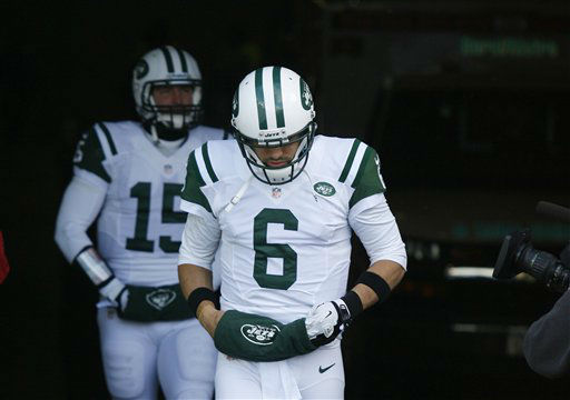 New York Jets quarterbacks Mark Sanchez &#40;6&#41; and Tim Tebow &#40;15&#41; walk to the field before an NFL football game against the Buffalo Bills on Sunday, Dec. 30, 2012, in Orchard Park, N.Y. &#40;AP Photo&#47;Bill Wippert&#41; <span class=meta>(AP Photo&#47; Bill Wippert)</span>