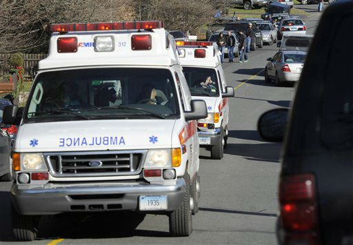 Ambulances leave an area near the scene of a shooting at the Sandy Hook Elementary School in Newtown, Conn., about 60 miles &#40;96 kilometers&#41; northeast of New York City, Friday, Dec. 14, 2012. An official with knowledge of Friday&#39;s shooting said 27 people were dead, including 18 children.  &#40;AP Photo&#47;Jessica Hill&#41; <span class=meta>(AP Photo&#47; Jessica Hill)</span>