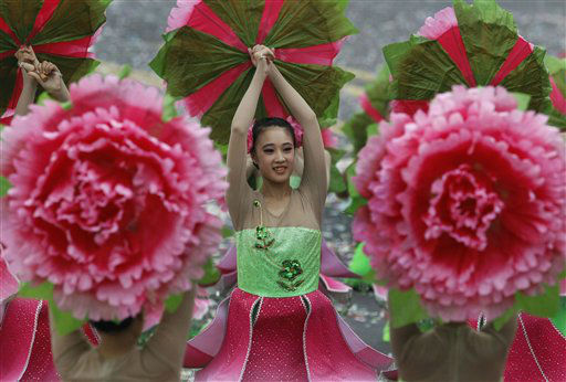 Young dancers perform during National Day celebrations marking the 101st anniversary of the founding of the Republic of China, in front of the Presidential Office in Taipei, Taiwan, Wednesday, Oct. 10, 2012. During the celebrations, President Ma Ying-jeou pledged greater efforts to fix the island&#39;s economy, now limping along at about a 2 percent annual growth rate. &#40;AP Photo&#47;Wally Santana&#41; <span class=meta>(AP Photo&#47; Wally Santana)</span>