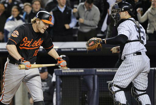 Baltimore Orioles&#39; Mark Reynolds &#40;12&#41; reacts after striking out as he walks past New York Yankees catcher Russell Martin &#40;55&#41; during the eighth inning of Game 5 of the American League division baseball series Friday, Oct. 12, 2012, in New York. &#40;AP Photo&#47;Bill Kostroun&#41; <span class=meta>(AP Photo&#47; Bill Kostroun)</span>