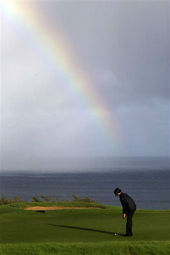 Bubba Watson putts in view of a rainbow behind on the 13th hole during the first round at the Tournament of Champions PGA golf tournament, Monday, Jan. 7, 2013, in Kapalua, Hawaii. Play was to have started three days earlier, but was delayed because of rain and high winds. &#40;AP Photo&#47;Elaine Thompson&#41; <span class=meta>(AP Photo&#47; Elaine Thompson)</span>