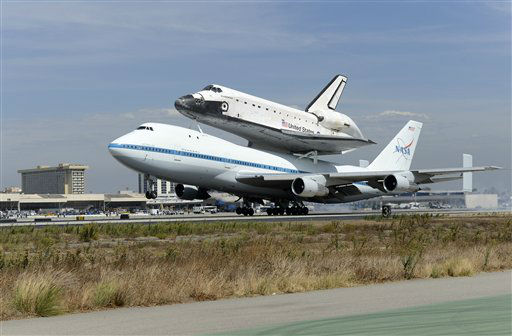 "<div class=""meta ""><span class=""caption-text "">The Space Shuttle Endeavour atop a modified 747 lands at Los Angeles International Airport on Friday, Sept. 21, 2012 in Los Angeles, Endeavour will be permanently displayed at the California Science Center in Los Angeles. (AP Photo/Kevork Djansezian, Pool)</span></div>"
