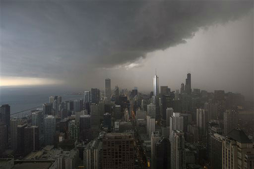 A thunderstorm with heavy rains approaches downtown Chicago, Monday, June 24, 2013. &#40;AP Photo&#47;Scott Eisen&#41; <span class=meta>(AP Photo&#47; Scott Eisen)</span>