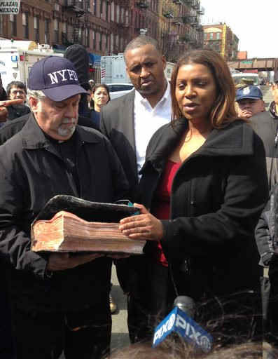 "<div class=""meta image-caption""><div class=""origin-logo origin-image ""><span></span></div><span class=""caption-text"">Rick Del Rio, pastor of Abounding Grace church in Manhattan, and New York City Public Advocate Letitia James, display a damaged but intact Bible they said was recovered in the rubble of the Spanish Christian Church, Saturday, March 15, 2014 in New York. The church was in one of the buildings destroyed in the March 12 gas explosion that leveled two building and killed eight people. (AP Photo/Jim Fitzgerald)  </span></div>"