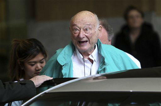 FILE - In this Dec. 10, 2012 file photo, former New York City Mayor Ed Koch says good-bye to reporters as he gets in his car after being released from the hospital in New York.  A spokesman says Koch now expects to get out of the hospital on Saturday, Jan. 26, 2013. Spokesman George Arzt said Friday that Koch originally expected to remain over the weekend at NewYork-Presbyterian&#47;Columbia hospital. But doctors changed their minds and decided to let him out Saturday instead. He was admitted  last Saturday night with fluid in his lungs and swollen ankles. Doctors have told the 88-year-old ex-mayor to limit his salt intake. &#40;AP Photo&#47;Seth Wenig, file&#41; <span class=meta>(AP Photo&#47; Seth Wenig)</span>