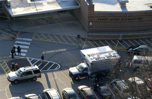 "<div class=""meta ""><span class=""caption-text "">Officials are on the scene outside of Sandy Hook Elementary School in Newtown, Conn., where authorities say a gunman opened fire inside an elementary school in a shooting that left 27 people dead, including 18 children, Friday, Dec. 14, 2012. (AP Photo/Julio Cortez) (AP Photo/ Julio Cortez)</span></div>"