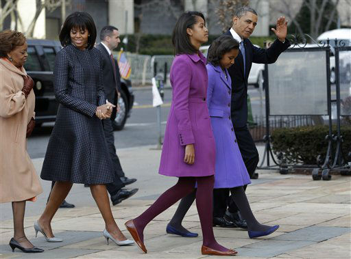 "<div class=""meta ""><span class=""caption-text "">President Barack Obama, waves as he walks with his daughters Sasha and Malia, first lady Michelle Obama and mother-in-law Marian Robinson, to St. John's Church in Washington, Monday, Jan. 21, 2013, for a church service during the 57th Presidential Inauguration. (AP Photo/Jacquelyn Martin) (AP Photo/ Jacquelyn Martin)</span></div>"