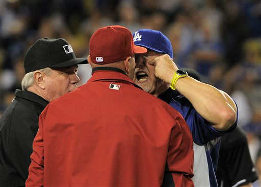 Los Angeles Dodgers batting coach Mark McGwire, right, yells at Arizona Diamondbacks manager Kirk Gibson after Los Angeles Dodgers&#39; Zack Greinke was hit by a pitch during the seventh inning of their baseball game, Tuesday, June 11, 2013, in Los Angeles.  &#40;AP Photo&#47;Mark J. Terrill&#41; <span class=meta>(AP Photo&#47; Mark J. Terrill)</span>
