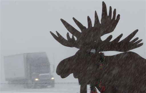 A truck drives in near whiteout conditions past a silhouette of a moose, on Interstate 80 near Gretna, Neb., Thursday, Feb. 21, 2013. Much of the nation&#39;s heartland is experiencing heavy snow, treacherous roads as potentially dangerous winter storm pushed eastward out of the Rockies. &#40;AP Photo&#47;Nati Harnik&#41; <span class=meta>(AP Photo&#47; Nati Harnik)</span>