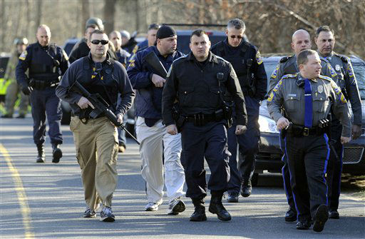 "<div class=""meta ""><span class=""caption-text "">Law enforcement canvass the area following a shooting at the Sandy Hook Elementary School in Newtown, Conn. where authorities say a gunman opened fire, leaving 27 people dead, including 20 children, Friday, Dec. 14, 2012. (AP Photo/Jessica Hill) (AP Photo/ Jessica Hill)</span></div>"