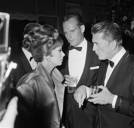 Italy&#39;s Gina Lollobrigida, American actor Charlton Heston, and American actor Kirk Douglas pictured at a party British-born actress Elizabeth Taylor and her husband, American singer Eddie Fisher, gave Oct. 14, 1961 in a fashionable Rome hotel, in honor of Kirk Douglas.   The party marked  the first anniversary of Douglas making giant film &#34;Spartacus&#34;  &#40;AP Photo&#47;Girolamo Di Majo&#41; <span class=meta>(AP Photo&#47; Girolamo Di Majo)</span>