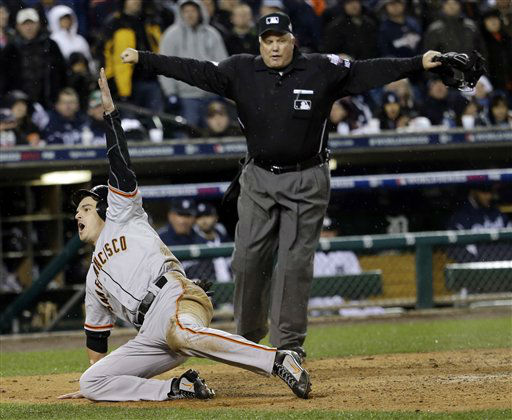 San Francisco Giants&#39; Ryan Theriot reacts after scoring from second on a hit by Marco Scutaro during the 10th inning of Game 4 of baseball&#39;s World Series against the Detroit Tigers Sunday, Oct. 28, 2012, in Detroit. &#40;AP Photo&#47;David J. Phillip&#41; <span class=meta>(AP Photo&#47; David J. Phillip)</span>