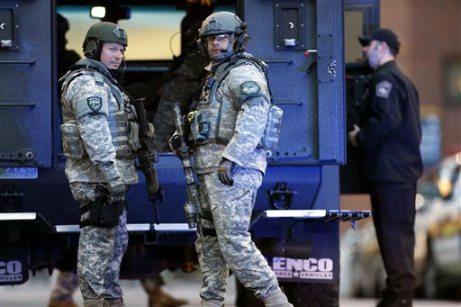 "<div class=""meta ""><span class=""caption-text "">S.W.A.T. team members stand guard on the campus of Massachusetts General Hospital following an explosion at the finish line of the Boston Marathon in Boston, Monday, April 15, 2013. (AP Photo/Michael Dwyer)</span></div>"