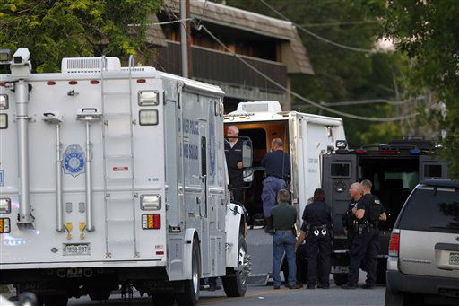 Police gather near an apartment house where the suspect in a shooting at a movie theatre lived in Aurora, Colo., Friday, July 20, 2012. As many as 14 people were killed and 50 injured at a shooting at the Century 16 movie theatre early Friday during the showing of the latest Batman movie. &#40;AP Photo&#47;Ed Andrieski&#41; <span class=meta>(AP Photo&#47; Ed Andrieski)</span>