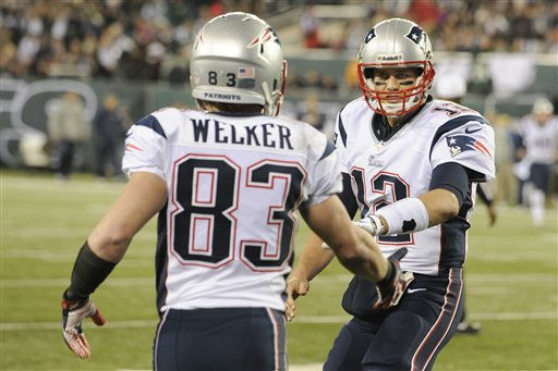 New England Patriots quarterback Tom Brady, right, celebrates with Wes Welker &#40;83&#41; after the two connected for a touchdown during the first half of an NFL football game against the New York Jets Thursday, Nov. 22, 2012 in East Rutherford, N.J. &#40;AP Photo&#47;Bill Kostroun&#41; <span class=meta>(AP Photo&#47; Bill Kostroun)</span>