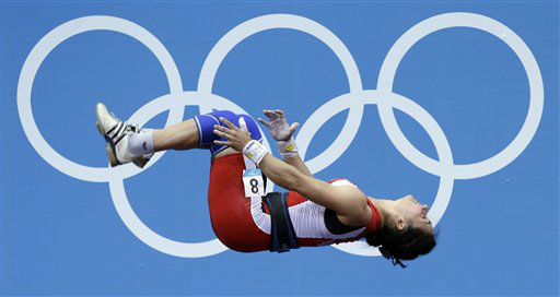 Romela Begaj of Albania does a back flip after competing during the women&#39;s 58-kg, group A, weightlifting competition at the 2012 Summer Olympics, Monday, July 30, 2012, in London. &#40;AP Photo&#47;Hassan Ammar&#41; <span class=meta>(AP Photo&#47; Hassan Ammar)</span>