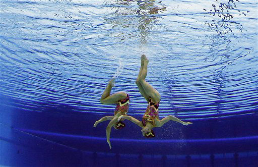 Sara Labrousse and Chloe Willhelm of France  compete during the women&#39;s duet synchronized swimming technical routine at the Aquatics Centre in the Olympic Park during the 2012 Summer Olympics in London, Sunday, Aug. 5, 2012. &#40;AP Photo&#47;Mark J. Terrill&#41; <span class=meta>(AP Photo&#47; Mark J. Terrill)</span>