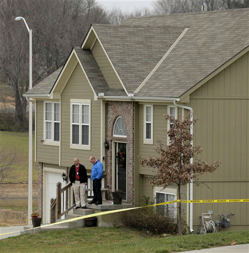 Investigators stand outside an Independence, Mo., house where police say Kansas City Chiefs linebacker Jovan Belcher fatally shot his girlfriend before driving to the NFL football team&#39;s training facility and shooting himself, Saturday, Dec. 1, 2012. &#40;AP Photo&#47;Charlie Riedel&#41; <span class=meta>(AP Photo&#47; Charlie Riedel)</span>