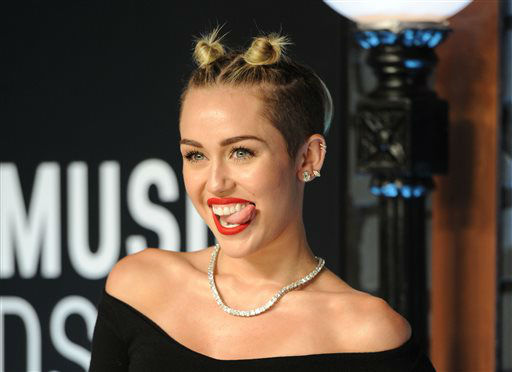 FILE - This Aug. 25, 2013 file photo shows singer Miley Cyrus at the MTV Video Music Awards in the Brooklyn borough of New York.  Cyrus was a top 10 finalist for the 2013 Time Person of the Year.  &#40;Photo by Evan Agostini&#47;Invision&#47;AP, File&#41; <span class=meta>(Photo&#47;Evan Agostini)</span>