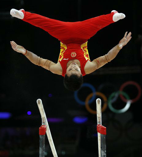 Chinese gymnast Feng Zhe performs on the parallel bars during the Artistic Gymnastic men&#39;s team final at the 2012 Summer Olympics, Monday, July 30, 2012, in London. &#40;AP Photo&#47;Matt Dunham&#41; <span class=meta>(AP Photo&#47; Matt Dunham)</span>
