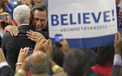 Republican presidential nominee Mitt Romney hugs a supporter as he walks to the stage during the Republican National Convention in Tampa, Fla., on Thursday, Aug. 30, 2012. &#40;AP Photo&#47;J. Scott Applewhite&#41; <span class=meta>(AP Photo&#47; J. Scott Applewhite)</span>