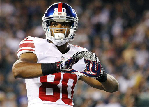 New York Giants wide receiver Victor Cruz celebrates after scoring a touchdown against the Philadelphia Eagles during the second half of an NFL football game, Sunday, Sept. 30, 2012, in Philadelphia. &#40;AP Photo&#47;Mel Evans&#41; <span class=meta>(AP Photo&#47; Mel Evans)</span>