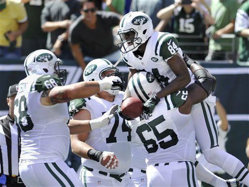 New York Jets wide receiver Stephen Hill &#40;84&#41; celebrates with teammates Matt Slauson &#40;68&#41; and Brandon Moore after scoring a touchdown during the first half of an NFL football game against the Buffalo Bills at MetLife Stadium, Sunday, Sept. 9, 2012, in East Rutherford, N.J. &#40;AP Photo&#47;Bill Kostroun&#41; <span class=meta>(AP Photo&#47; Bill Kostroun)</span>