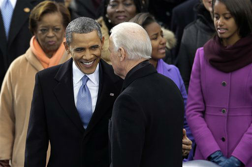 "<div class=""meta ""><span class=""caption-text "">President Barack Obama greets Vice President Joe Biden at the ceremonial swearing-in at the U.S. Capitol during the 57th Presidential Inauguration in Washington, Monday, Jan. 21, 2013. (AP Photo/Carolyn Kaster) (AP Photo/ Carolyn Kaster)</span></div>"