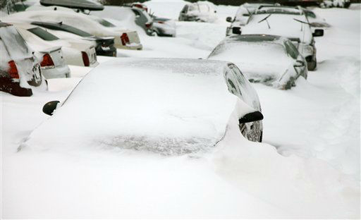 Cars sit buried by snowdrifts in a parking lot in Southington, Conn., Saturday, Feb. 9, 2013, after a heavy snowfall and high winds from a storm dumped more than 2 feet of snow on New England. &#40;AP Photo&#47;Robert Ray&#41; <span class=meta>(AP Photo&#47; Robert Ray)</span>
