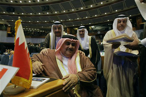 Bahraini Foreign Minister Sheik Khalid bin Ahmed Al Khalifa, seated at center, is greeted with a delegate prior to start of Non-Aligned Movement ministers meeting in Tehran, Iran, Tuesday, Aug. 28, 2012. Iran is currently hosting a weeklong gathering of the 51-year-old movement, which ends Friday. &#40;AP Photo&#47;Vahid Salemi&#41; <span class=meta>(AP Photo&#47; Vahid Salemi)</span>