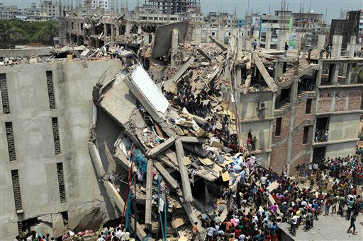 People and rescuers gather after an eight-story building housing several garment factories collapsed in Savar, near Dhaka, Bangladesh, Wednesday, April 24, 2013. Dozens were killed and many more are feared trapped in the rubble. &#40;AP Photo&#47; A.M. Ahad&#41; <span class=meta>(AP Photo&#47; A.M. Ahad)</span>