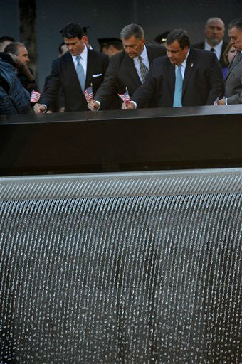 New Jersey Governor Chris Christie, left, places a flag on a memorial site as friends and relatives of the victims of the Sept. 11 terrorist attacks on the World Trade Center attend a ceremony marking the 11th anniversary of the attacks at the National September 11 Memorial at the World Trade Center site in New York, Tuesday, Sept. 11, 2012. &#40;AP Photo&#47;The Daily News, Todd Maisel, Pool&#41; <span class=meta>(AP Photo&#47; Todd Maisel)</span>