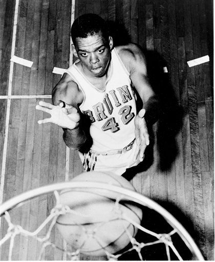 In this 1962 file photo, UCLA basketball guard Walt Hazzard, poses under a net.  Hazzard, the former UCLA and NBA star who played on the Bruins&#39; first NCAA championship basketball team in 1964 and later coached the team for four seasons in the 1980s, has died. He was 69. The school says Hazzard died Friday, Nov. 18, 2011, at UCLA Ronald Reagan Medical Center after a long illness. &#40;AP Photo, File&#41; <span class=meta>(AP Photo&#47; Anonymous)</span>
