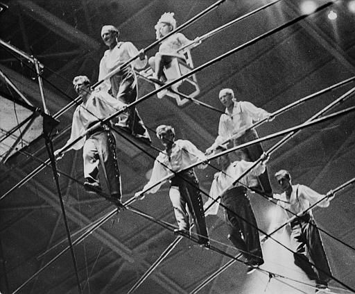 The Great Wallendas circus troupe walk the high wire during their three-tier seven-man pyramid performance at the State Fair Coliseum in Detroit, Michigan on Jan. 30, 1962.  From left to right, bottom row, are, Dieter Schepp, 23; Mario Wallenda, 21; Richard Faughnan, 29; Gunther Wallenda, 42.  Second row, left to right, Karl Wallenda, 57; Herman Wallenda, 60.  Sitting on chair is Jana Schepp, 17.  Karl&#39;s son-in-law Faughnan and nephew Schepp were killed when the pyramid formation collapsed and the performers fell to the ground.  Dieter&#39;s sister Jana and Karl&#39;s son Mario were injured.  &#40;AP Photo&#41; <span class=meta>(AP Photo&#47; XNBG)</span>